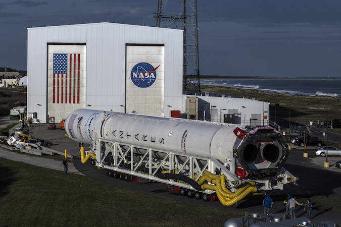 The Antares 230 rocket, featuring new RD-181 engines, emerges from the Horizontal Integration Facility on Thursday evening. Credit: Orbital ATK