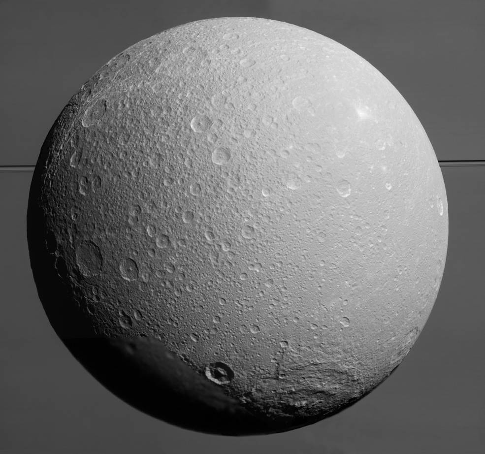 This view from NASA's Cassini spacecraft looks toward Saturn's icy moon Dione, with giant Saturn and its rings in the background, just prior to the mission's final close approach to the moon on Aug. 17, 2015. Credit: NASA/JPL-Caltech/Space Science Institute