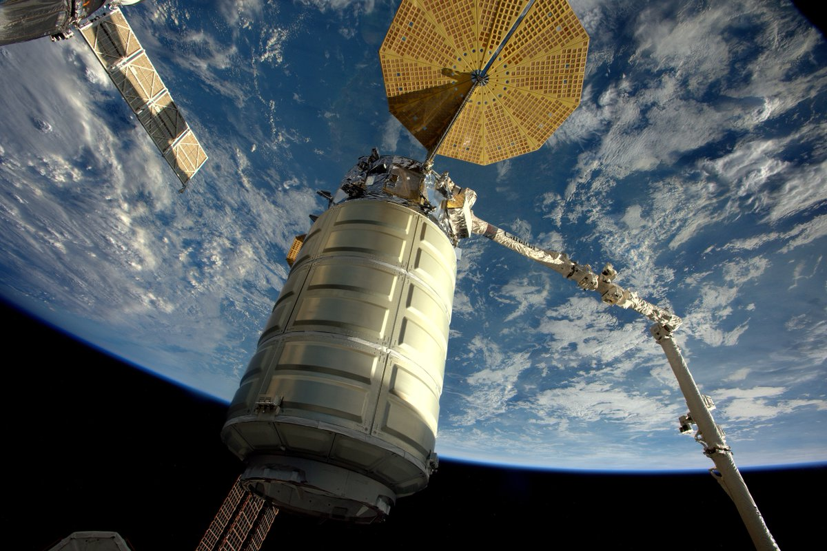 The Cygnus spaceship is seen suspended on the end of the space station's robotic arm before release Monday. Credit: NASA/ESA/Thomas Pesquet