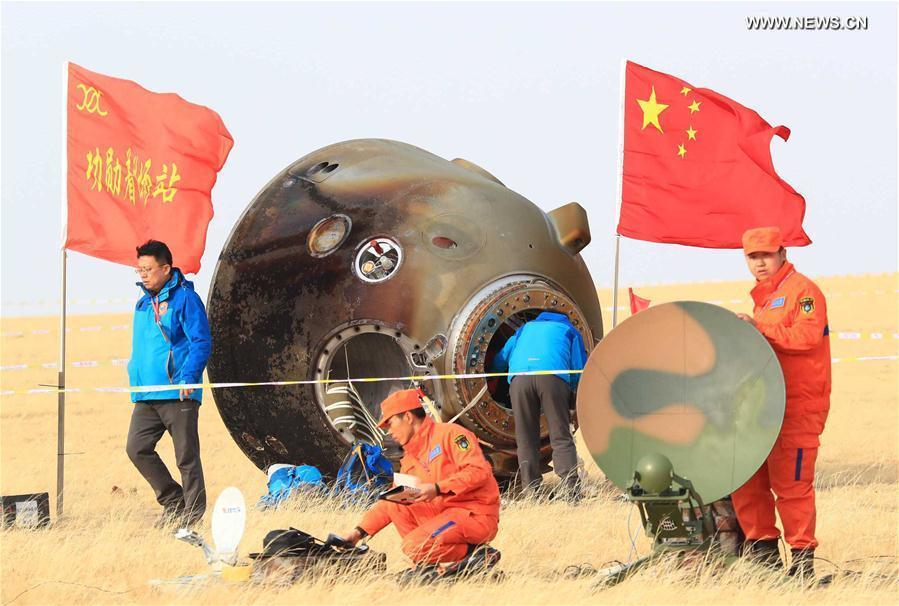 China's spacecraft recovery team works around the Shenzhou 11 landing capsule Friday after its touchdown in Inner Mongolia. Credit: Xinhua