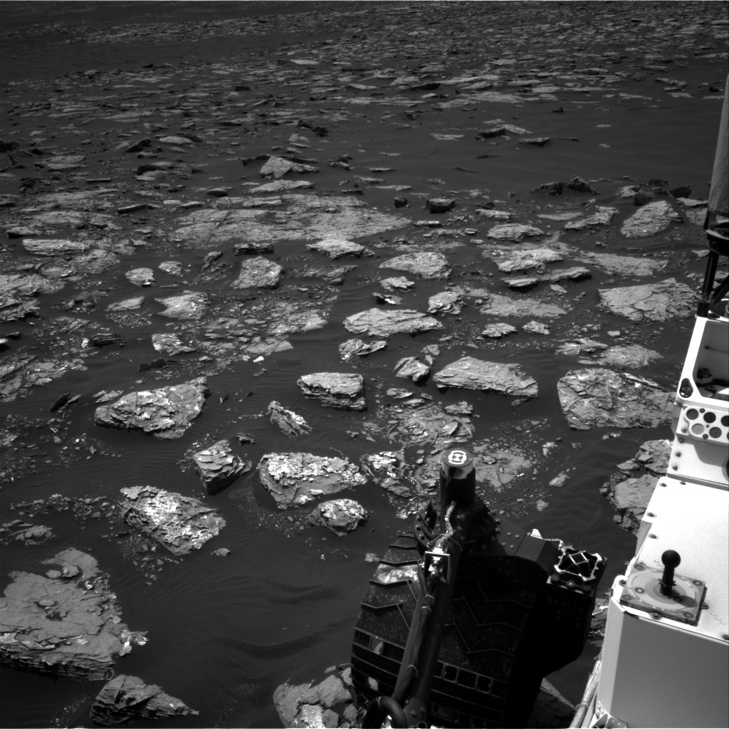"""This view from the Navigation Camera on the mast of NASA's Curiosity Mars rover taken Dec. 2, 2016, shows rocky ground within view while the rover was working at an intended drilling site called """"Precipice"""" on lower Mount Sharp. Credit: NASA/JPL-Caltech"""