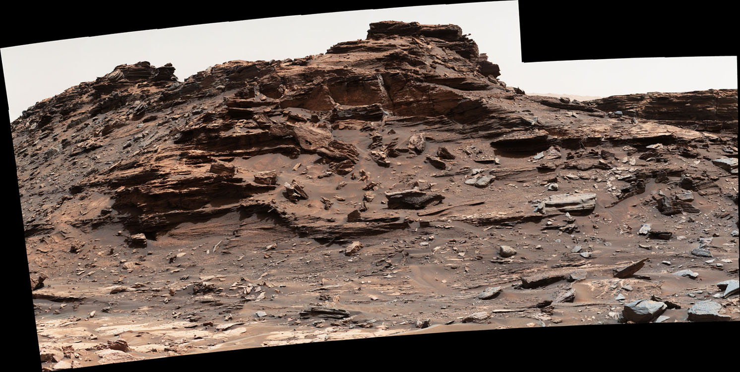 """The mast camera on the Curiosity rover captured this view of a butte standing about 16 feet (5 meters) above the vehicle Sept. 1, 2016, while the spacecraft was driving through the scenic """"Murray Buttes"""" region on Mars. Credit: NASA/JPL-Caltech/MSSS"""