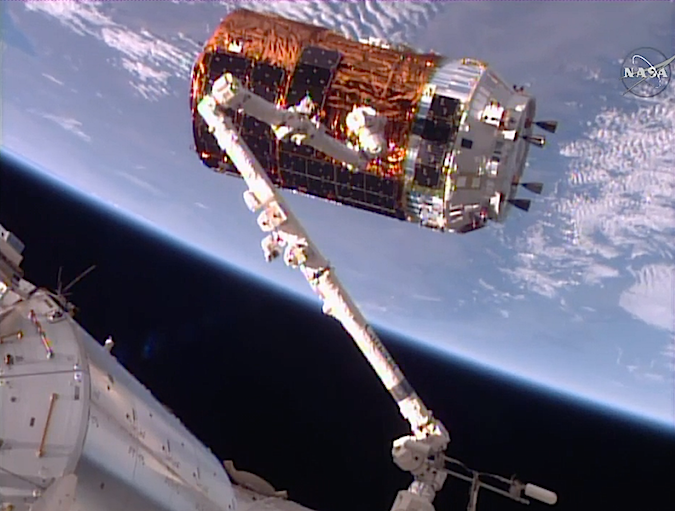 The sixth Japanese HTV supply ship was grappled by the space station's robotic arm at 1037 GMT (5:37 a.m. EST) Tuesday after a four-day pursuit following launch on an H-2B rocket. Credit: NASA TV/Spaceflight Now